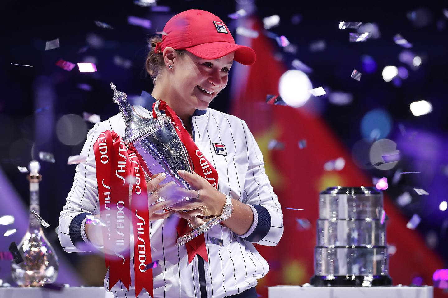 Ashleigh Barty of Australia holds her trophy while being showered by confetti after winning the WTA Finals Tennis Tournament against Elina Svitolina of Ukraine at the Shenzhen Bay Sports Center in Shenzhen, China's Guangdong province, Sunday, Nov. 3, 2019. (AP Photo/Andy Wong)