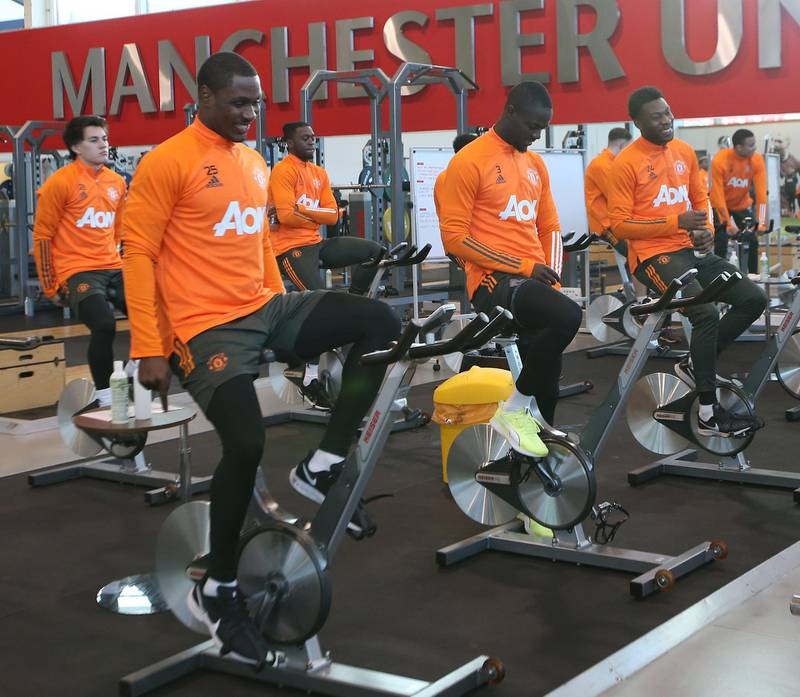 MANCHESTER, ENGLAND - DECEMBER 27: (EXCLUSIVE COVERAGE) Odion Ighalo, Eric Bailly, Timothy Fosu-Mensah of Manchester United in action during a first team training session at Aon Training Complex on December 27, 2020 in Manchester, England. (Photo by Matthew Peters/Manchester United via Getty Images)