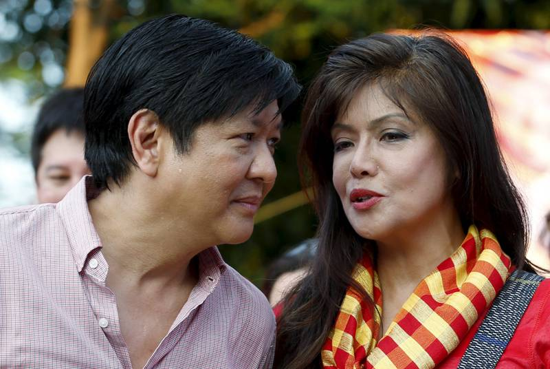 Vice Presidential candidate Ferdinand Marcos Jr (L) talks to his sister, Ilocos Norte Governor Imee Marcos during a political rally in Manila, October 10, 2015. Election season is under way in the Philippines and investors are in for a wild ride of power-politics dominated by entrenched family dynasties, whose machinations will leave little room for serious debate on badly needed reforms. The wife, son, daughter and nephew of late dictator Ferdinand Marcos will all run in the May 2016 elections, joining a host of other privileged candidates from elite families seeking to keep their hold on power in local and national politics. Picture taken October 10, 2015. REUTERS/Erik De Castro