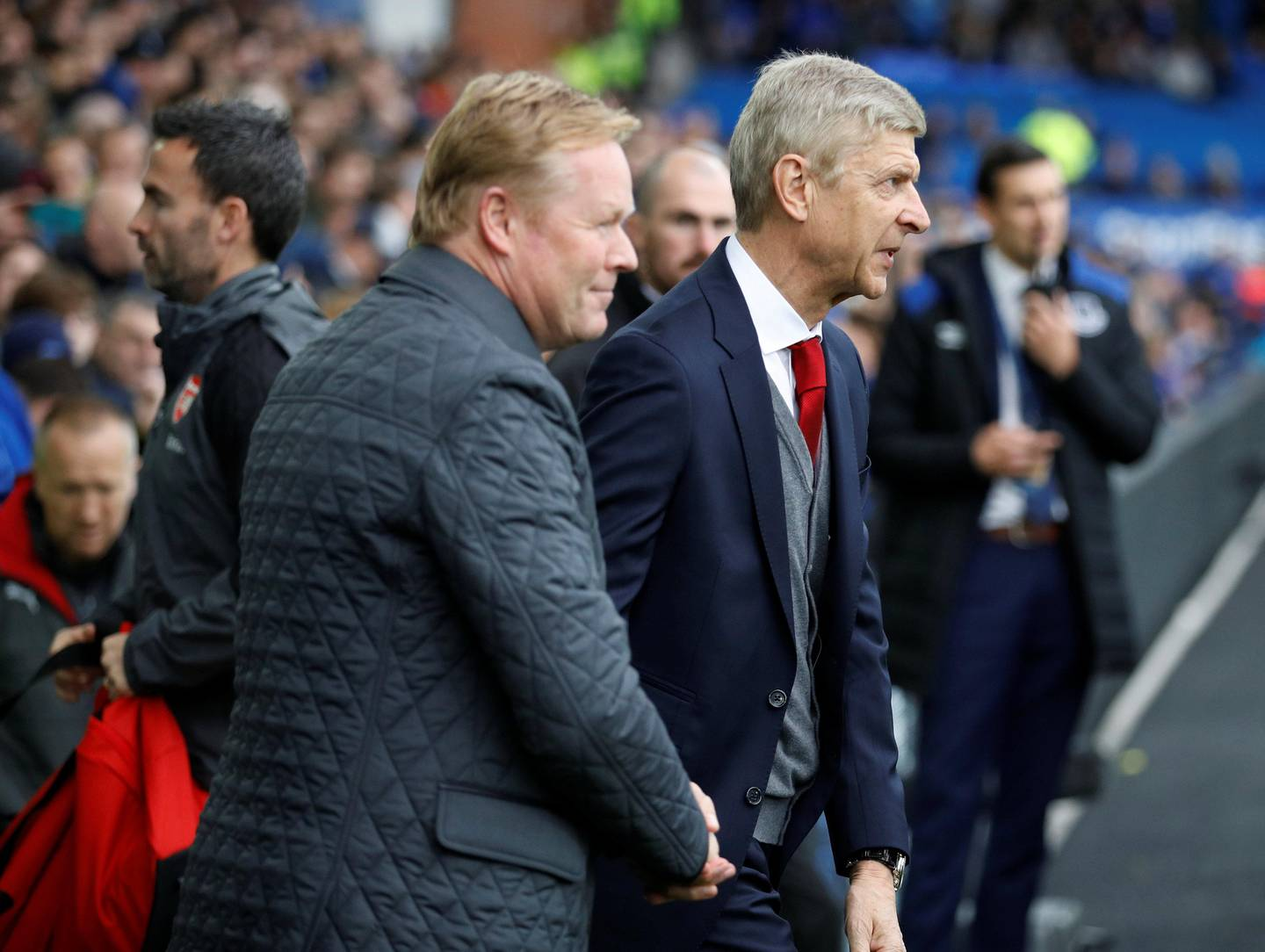 """Soccer Football - Premier League - Everton vs Arsenal - Goodison Park, Liverpool, Britain - October 22, 2017   Everton manager Ronald Koeman and Arsenal manager Arsene Wenger before the match    REUTERS/Phil Noble    EDITORIAL USE ONLY. No use with unauthorized audio, video, data, fixture lists, club/league logos or """"live"""" services. Online in-match use limited to 75 images, no video emulation. No use in betting, games or single club/league/player publications. Please contact your account representative for further details."""