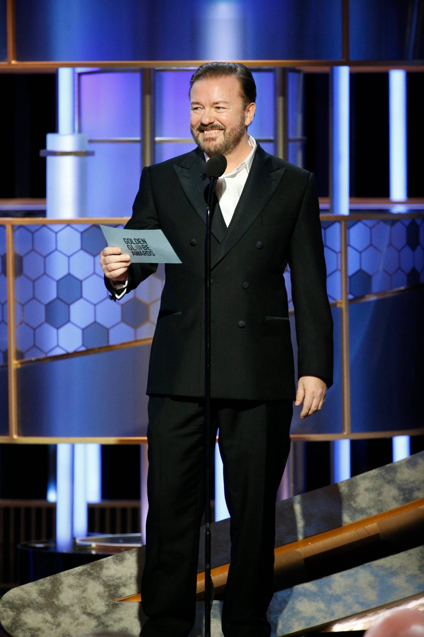 This image released by NBC shows host Ricky Gervais at the 77th Annual Golden Globe Awards at the Beverly Hilton Hotel in Beverly Hills, Calif., on Sunday, Jan. 5, 2020. (Paul Drinkwater/NBC via AP)