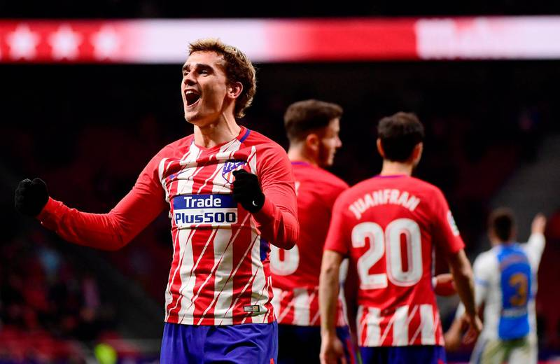 TOPSHOT - Atletico Madrid's French forward Antoine Griezmann celebrates his third goal during the Spanish league football match Club Atletico de Madrid against Club Deportivo Leganes SAD at the Wanda Metropolitano stadium in Madrid on February 28, 2018. / AFP PHOTO / PIERRE-PHILIPPE MARCOU