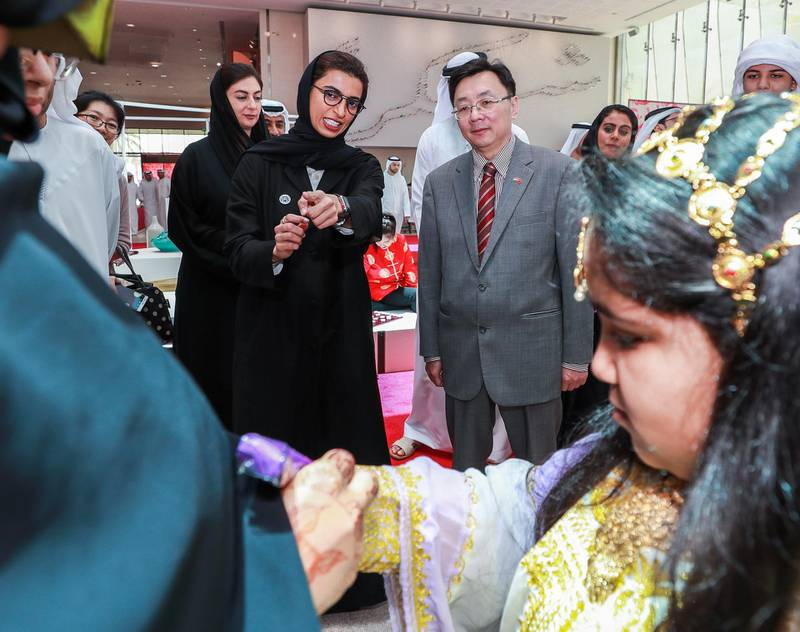Abu Dhabi, U.A.E., July 17, 2018.   The Launch of China Week at Manarat Al Saadiyat with guests of honor, Noura Al Kaabi, Minister of Culture and Knowledge Development and Ni Jian, Ambassador of China (R) observe a henna arts activity. Victor Besa / The NationalSection:  NAReporter:  John Dennehy