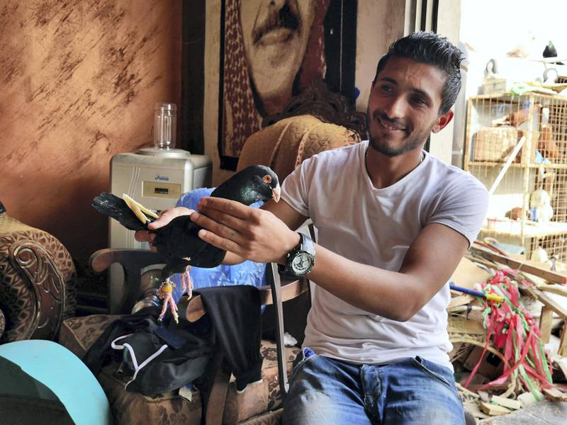 Zaid Al-Otayat, 26, holds up the family's most valuable bird, worth 1,000 JD. Picture by Charlie Faulkner