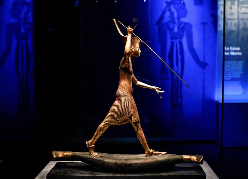 A statuette of Tutankhamun is displayed during the exhibition 'Tutankhamun,Treasures of the Golden Pharaoh' on March 21, 2019 at La Villette in Paris. - The exhibition dedicated to the famous Pharaoh Tutankhamun, with 150 original objects collected from his tomb, takes place in the Grande Halle de La Villette in Paris from March 23 to September 15, 2019. (Photo by STEPHANE DE SAKUTIN / AFP) / RESTRICTED TO EDITORIAL USE - TO ILLUSTRATE THE EVENT AS SPECIFIED IN THE CAPTION