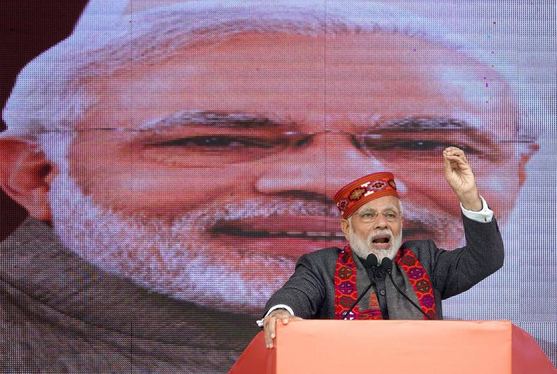 epa07250201 Indian Prime Minister Narendra Modi addresses the gathering during a Bharatiya Janata Party's (BJP) 'Jan Abhar Rally', in Dharamsala, India, 27 December 2018. The rally was organized by the BJP to celebrate one year completion of BJP government in the state of Himachal Pradesh.  EPA/SANJAY BAID