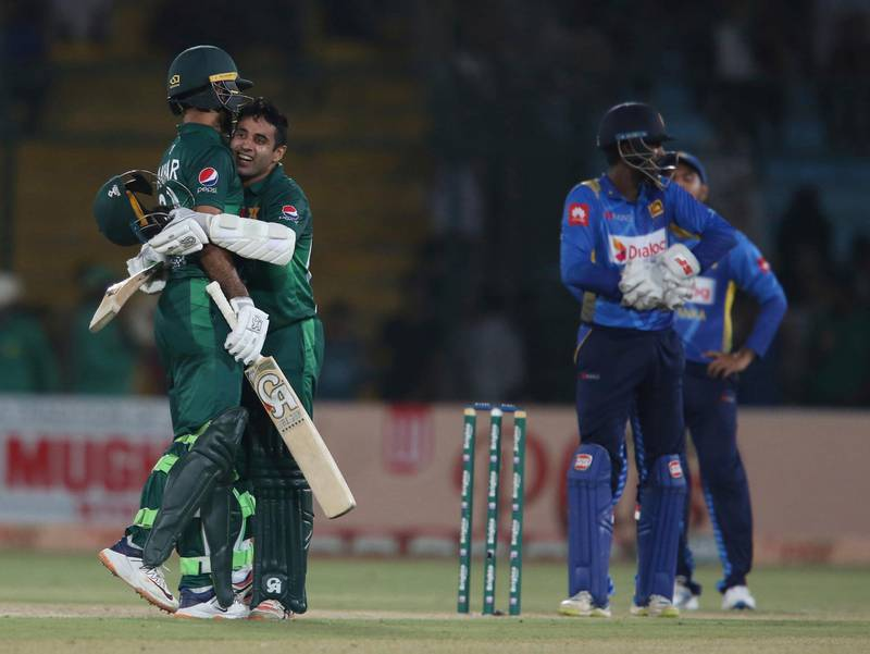 Pakistan's Abid Ali, second from left, celebrates his fifty against Sri Lanka in Karachi, Pakistan, Wednesday, Oct. 2, 2019. Pakistan capitalized on a brisk century opening stand between Fakhar Zaman and Abid Ali to beat Sri Lanka by five wickets in the third and final one-day international on Wednesday, clinching the series 2-0. (AP Photo/Fareed Khan)