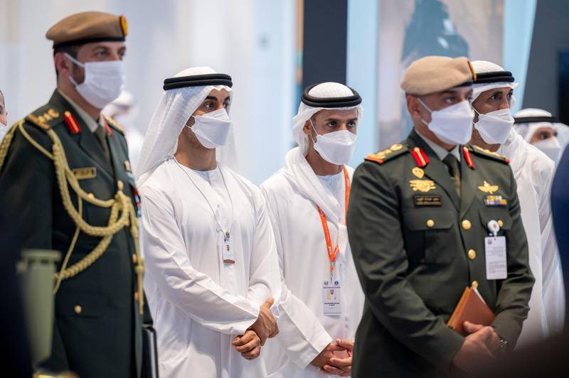 ABU DHABI, UNITED ARAB EMIRATES - February 23, 2021: HH Sheikh Hamdan bin Mohamed bin Zayed Al Nahyan (2nd L) and HH Sheikh Mohamed bin Hamad bin Tahnoon Al Nahyan (3rd L), tour the International Defence Exhibition and Conference (IDEX), at ADNEC.  ( Mohamed Al Hammadi / Ministry of Presidential Affairs ) ---