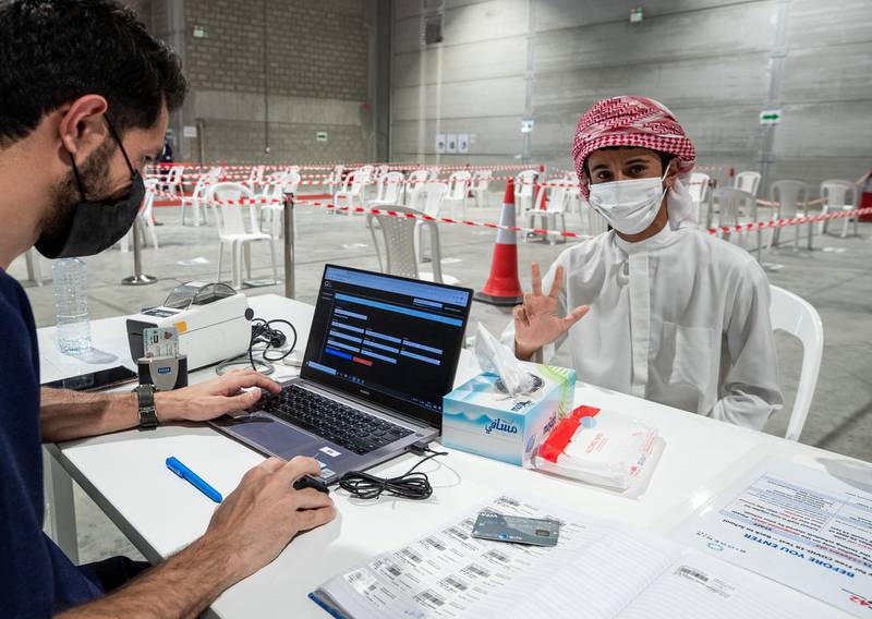 Abu Dhabi, United Arab Emirates, March 18, 2021.  Mohammed Almansoori registers before getting his PCR test at the Biogenix lab at G42 in Masdar City.Victor Besa/The NationalSection:  NAReporter:  Shireena Al Nowais