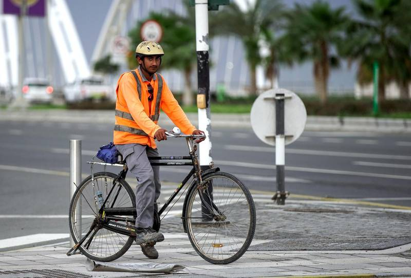 Abu Dhabi, United Arab Emirates, March 21, 2020.   A worker on his way to work at the Al Bandar area on a gloomy day.Victor Besa / The NationalReporter:   Section: