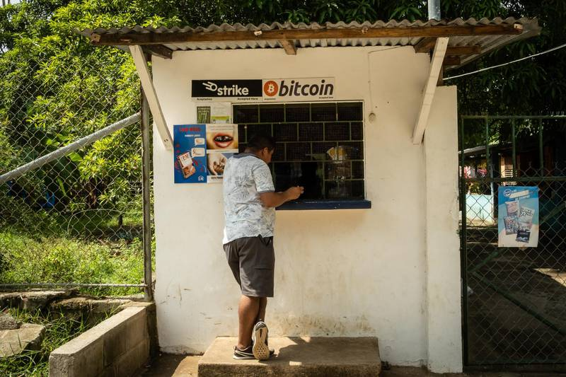 A person purchases a bottle of Coca-Cola from a shop that accepts Bitcoin in El Zonte, El Salvador, on Monday, June 14, 2021. El Salvador has become the first country to formally adopt Bitcoin as legal tender after President Nayib Bukele said congress approved his landmark proposal. Photographer: Cristina Baussan/Bloomberg