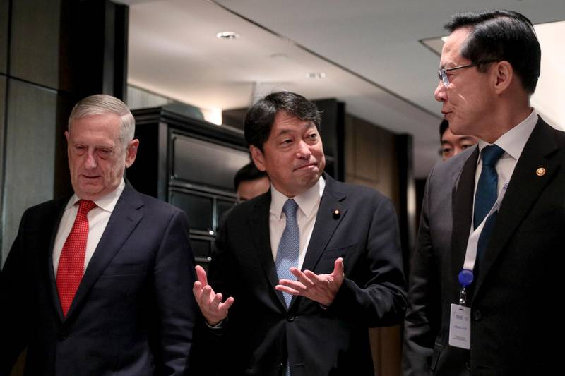 epa06781685 Japanese Defense Minister Itsunori Onodera (C) leaves a trilateral meeting with US Secretary of Defense James Mattis (L), and South Korean National Defense Minister Song Young-moo (R) on the sidelines of a International Institute for Strategic Studies (IISS) 17th Asia Security Summit in Singapore, 03 June 2018. The IISS Asia Security Summit is an annual gathering of defense officials in the Asia-Pacific region and is dubbed the Shangri-La Dialogue in honor of the hotel where the event is held. The summit will be held from 01 to 03 June 2018.  EPA/WALLACE WOON