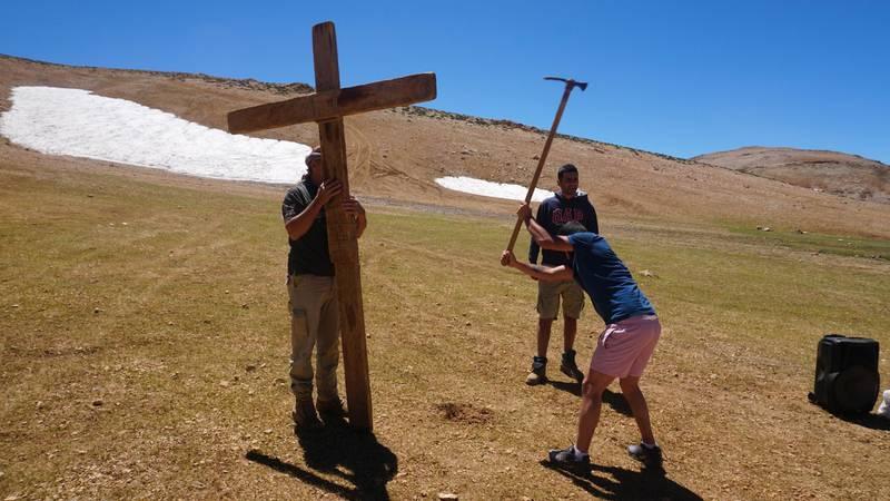 Men dig a hole to plant a cross before mass on Qornet Al Sawda, Lebanon, August 9, 2020. Photo by Aram Abdo