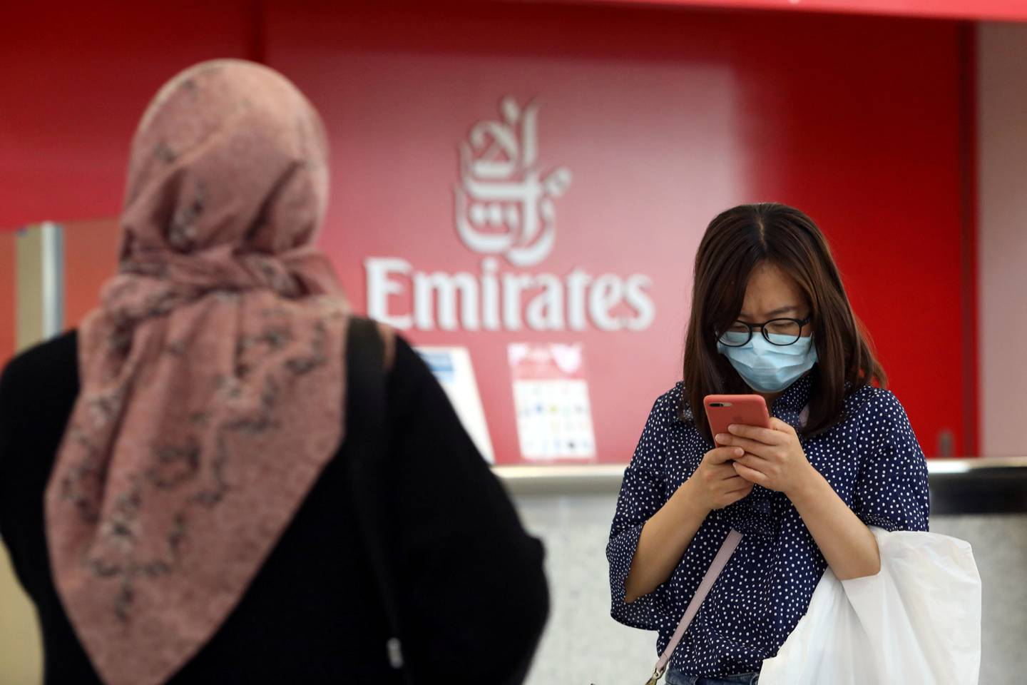 FILE PHOTO: A traveller wears a mask at the Dubai International Airport, after the UAE's Ministry of Health and Community Prevention confirmed the country's first case of coronavirus, in Dubai, United Arab Emirates January 29, 2020. REUTERS/Christopher Pike - RC2JPE94N0K9/File Photo