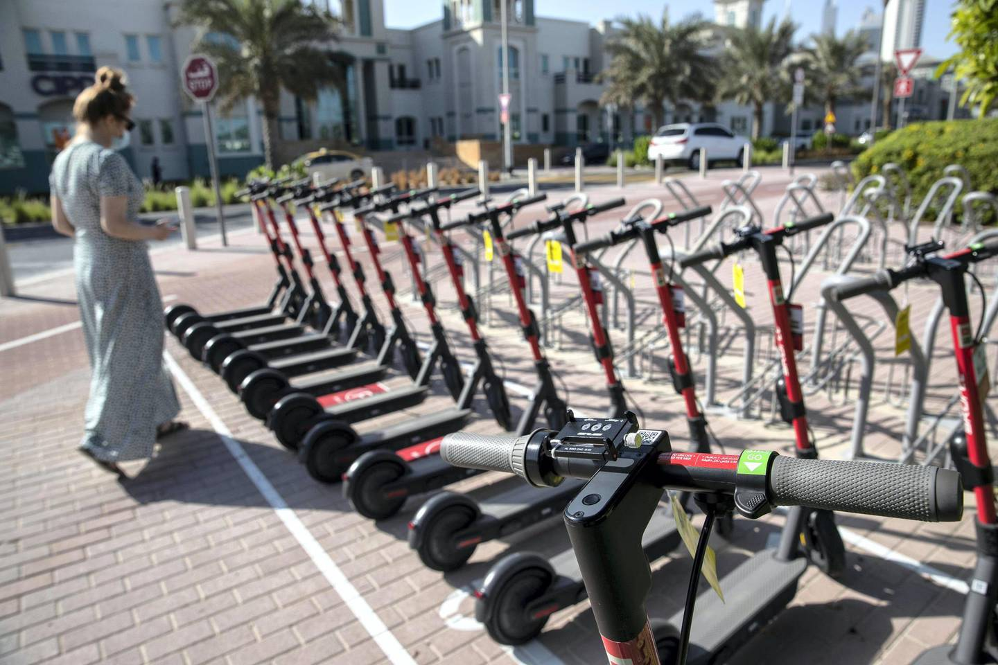 DUBAI, UNITED ARAB EMIRATES. 26 OCTOBER 2020. E-scooter trials rolled out in five areas across city for a year long project for commuters to rent and use e-scooters while commuting to and from tram and metro stations. SKURTT e-scooters for rent in Knowledge Village. (Photo: Antonie Robertson/The National) Journalist: Kelly Clarke. Section: National.