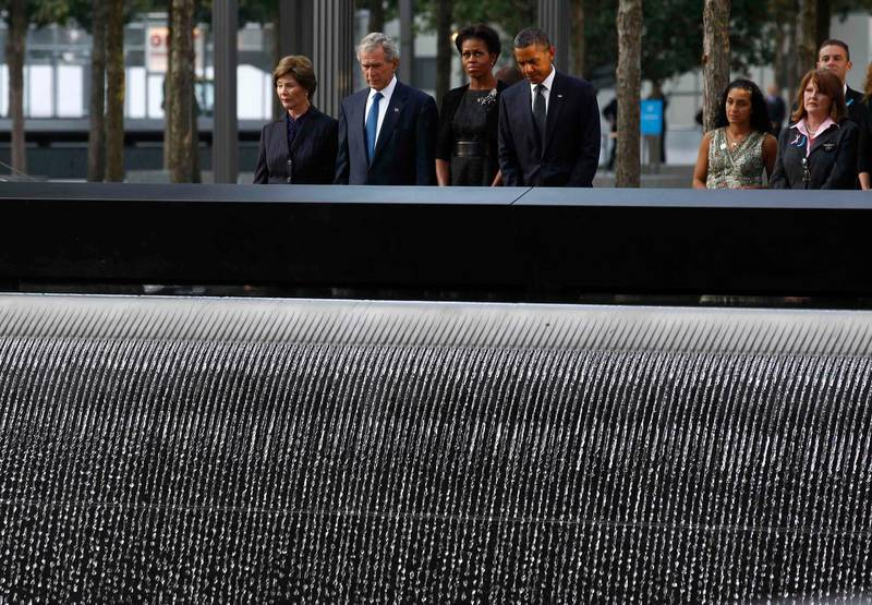 U.S. President Barack Obama and first lady Michelle Obama are joined by former President George W. Bush and his wife Laura Bush during ceremonies marking the 10th anniversary of the 9/11 attacks on the World Trade Center in New York, September 11, 2011.  REUTERS/Jim Young   (UNITED STATES - Tags: DISASTER ANNIVERSARY TPX IMAGES OF THE DAY) *** Local Caption ***  WTC816_SEPT11-_0911_11.JPG