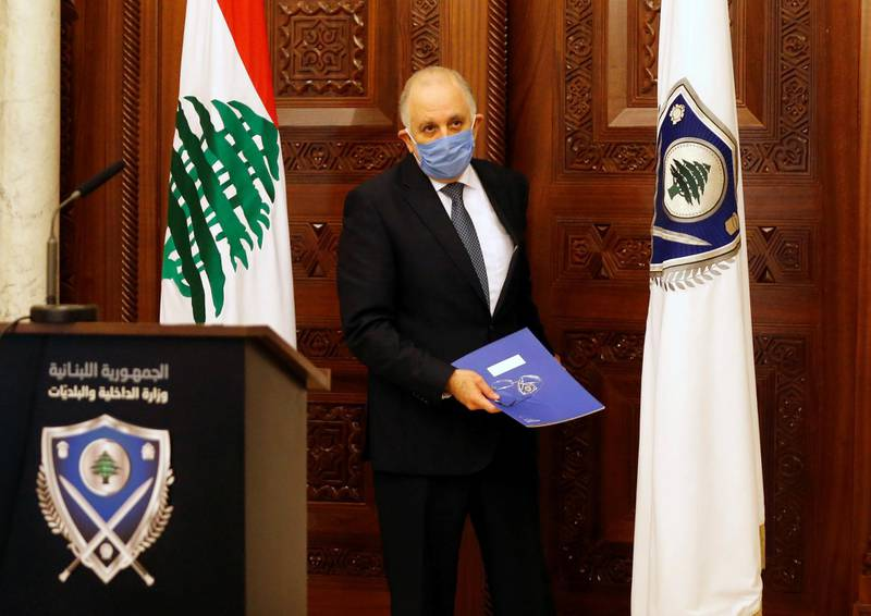Lebanon's Interior Minister, Mohammad Fahmi wears a protective mask as he arrives for a news conference, after Lebanese Prime Minister, Hassan Diab asked the security forces on Saturday to enforce stricter measures to keep people indoors and prevent gatherings to curb the coronavirus disease (COVID-19) outbreak, in Beirut, Lebanon March 22, 2020. REUTERS/Mohamed Azakir