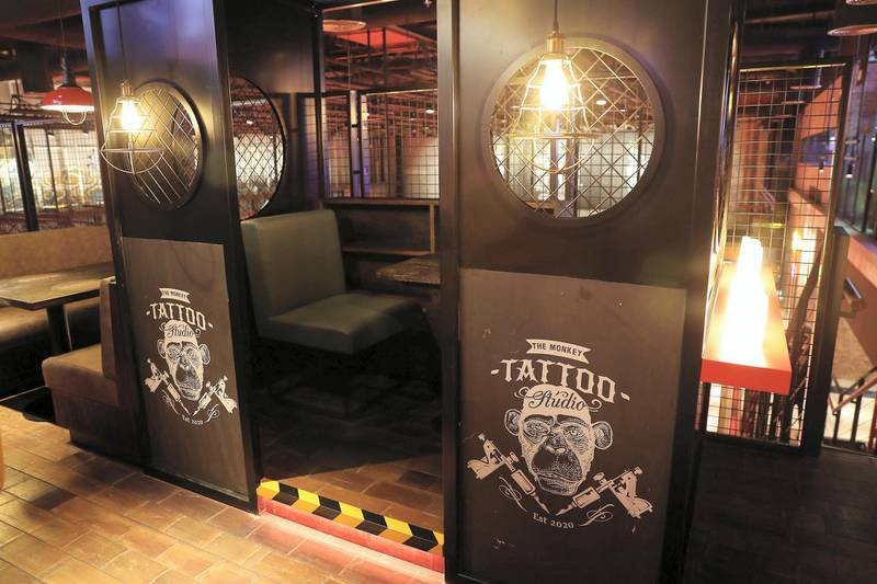 DUBAI, UNITED ARAB EMIRATES , September 27 – 2020 :- View of the tattoo studio at the Brass Monkey, new dining and entertainment destination on the Bluewaters Island in Dubai.  (Pawan Singh / The National) For Lifestyle/Online/Instagram. Story by Janice Rodrigues