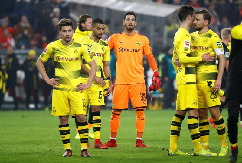 Soccer Football - Bundesliga - VfB Stuttgart vs Borussia Dortmund - Mercedes-Benz Arena, Stuttgart, Germany - November 17, 2017   Borussia Dortmund's Roman Burki and team mates look dejected after the match   REUTERS/Kai Pfaffenbach    DFL RULES TO LIMIT THE ONLINE USAGE DURING MATCH TIME TO 15 PICTURES PER GAME. IMAGE SEQUENCES TO SIMULATE VIDEO IS NOT ALLOWED AT ANY TIME. FOR FURTHER QUERIES PLEASE CONTACT DFL DIRECTLY AT + 49 69 650050