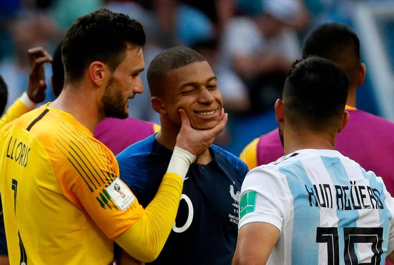 epa06852503 Goalkeeper Hugo Lloris of France (L) and Kylian Mbappe of France (C) react after the FIFA World Cup 2018 round of 16 soccer match between France and Argentina in Kazan, Russia, 30 June 2018.  (RESTRICTIONS APPLY: Editorial Use Only, not used in association with any commercial entity - Images must not be used in any form of alert service or push service of any kind including via mobile alert services, downloads to mobile devices or MMS messaging - Images must appear as still images and must not emulate match action video footage - No alteration is made to, and no text or image is superimposed over, any published image which: (a) intentionally obscures or removes a sponsor identification image; or (b) adds or overlays the commercial identification of any third party which is not officially associated with the FIFA World Cup)  EPA/YURI KOCHETKOV   EDITORIAL USE ONLY  EPA-EFE/YURI KOCHETKOV   EDITORIAL USE ONLY  EDITORIAL USE ONLY