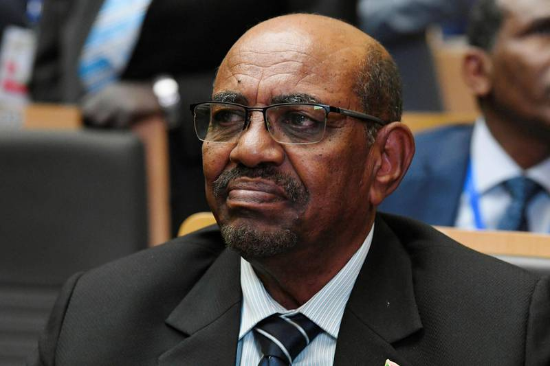 (FILES) In this file photo taken on January 28, 2018 Sudanese President Omar al-Bashir attends the opening of the Ordinary Session of the Assembly of Heads of State and Government during the 30th annual African Union summit in Addis Ababa. Sudan has agreed to hand over ousted autocrat Omar al-Bashir and others to the International Criminal Court for alleged war crimes in Darfur, a top official of the new ruling body said Tuesday. The Hague-based ICC has charged Bashir and three of his former aides with genocide, crimes against humanity and war crimes in Sudan's western region of Darfur, which was hit by a brutal conflict from 2003.  / AFP / SIMON MAINA