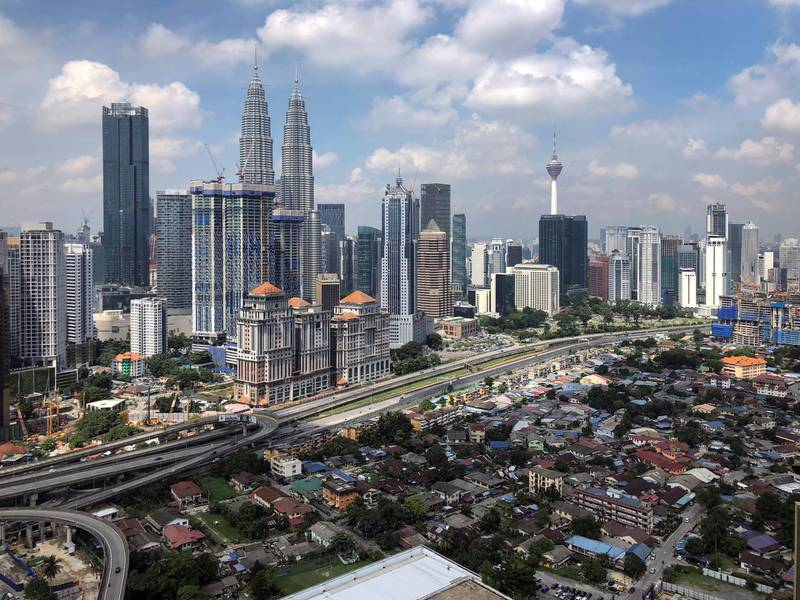 This May 25, 2018, photo show a general view of capital city of Kuala Lumpur, Malaysia. Malaysia's new Prime Minister Mahathir Mohamad said Wednesday, May 30, 2018, the government will set up a trust fund to let the public contribute to easing the country's huge national debt. (AP Photo/Vincent Thian)