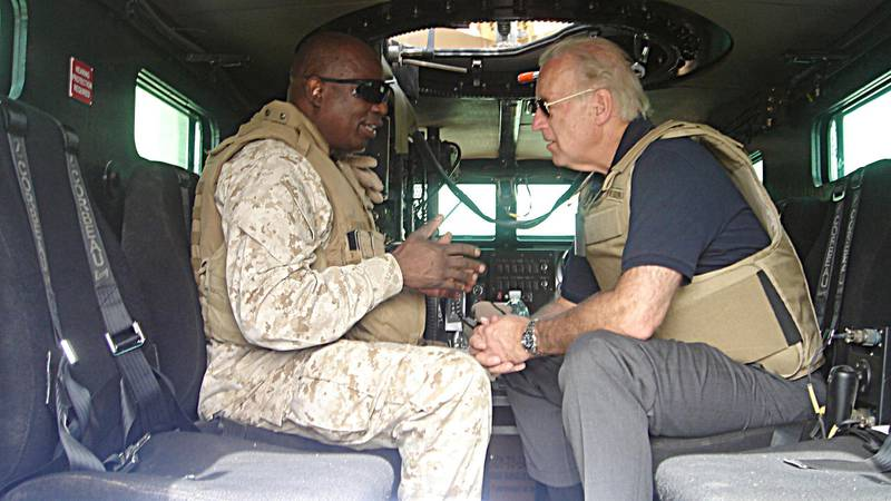 This 06 September, 2007 photo, courtesy of US Senator Joseph Biden's office, shows the Delaware Senator speaking with an unidentified soldier inside a Mine Resistant Ambush Protected (MRAP) vehicle during a visit to Ramadi, Iraq. AFP PHOTO/HO/Courtesy of Senator Biden's office/RESTRICTED TO EDITORIAL USE/ GETTY OUT (Photo by HO / Joe Biden / AFP)