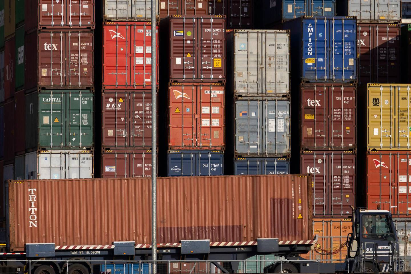 """FELIXSTOWE, ENGLAND - NOVEMBER 16: Crates are stacked at Felixtowe Port on November 16, 2020 in Felixstowe, England. Shipping companies and retailers have complained of delays in unloading arriving freight, with one ship told it could wait up to 10 days for a berthing slot. The port's owner, Hutchison Ports UK, said """"the imbalance in UK trade and Brexit stockpiling exacerbate current operational challenges and we are working with our customers and stakeholders to get through the current congestion."""" (Photo by Dan Kitwood/Getty Images)"""