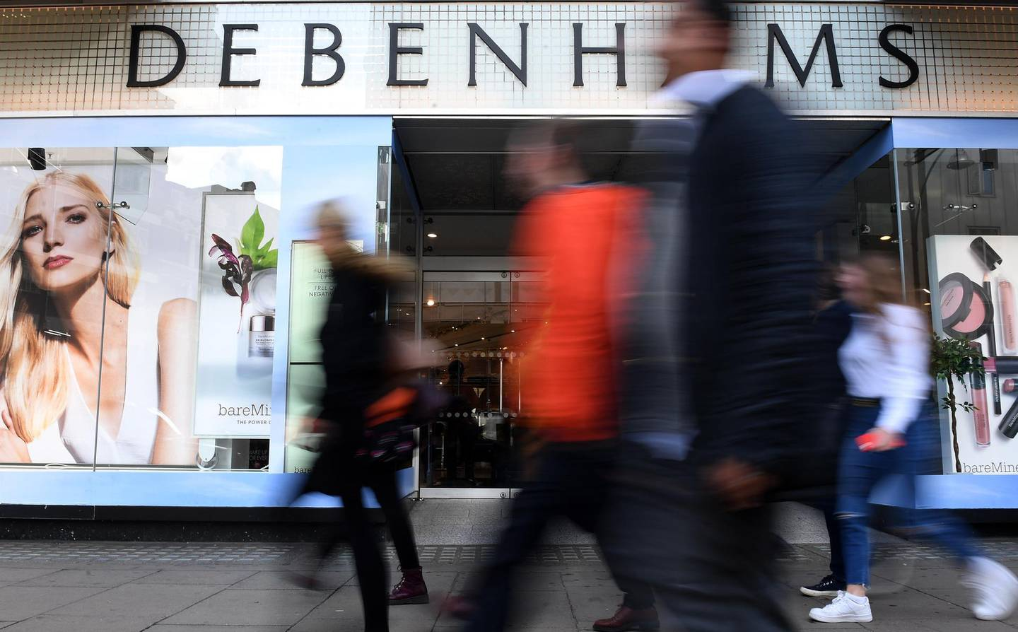 epa07493676 (FILE) - Pedestrians pass a Debenhams store in Oxford Street in London, Britain, 25 October 2018 (reissued 09 April 2019). Reports on 09 April 2019 state Debenhams may be close to administration after rejecting an offer valued at 200 million pounds by Sports Direct to invest in the company. Debenhams that employs 25,000 staff has 640 million pounds worth of debt and issued three profit warnings in 2018.  EPA/ANDY RAIN