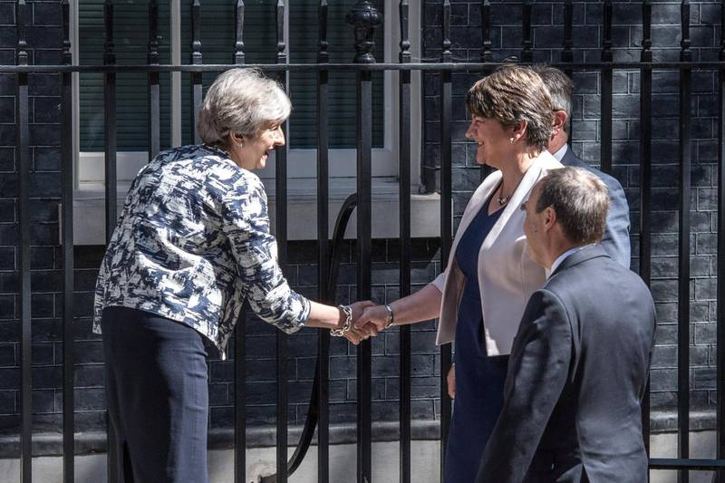 LONDON, ENGLAND - JUNE 26:  Britain's Prime Minister, Theresa May (L), greets Arlene Foster, the leader of Northern Ireland's Democratic Unionist Party (C), deputy leader of the Democratic Unionist Party, Nigel Dodds (R) and DUP MP Jeffrey Donaldson (at rear) as they arrive in Downing Street on June 26, 2017 in London, England. Mrs Foster has said a deal between her party and the Conservatives to support a minority government is close.  (Photo by Carl Court/Getty Images)