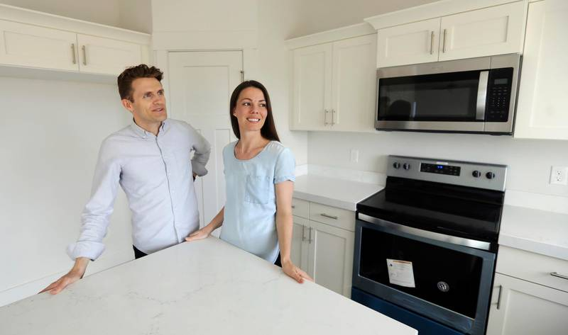 ADVANCE FOR RELEASE SATURDAY MAY 25, 2019, AND THEREAFTER - In this April 27, 2019, photo, Andy and Stacie Proctor stand in their new home in Vineyard, Utah. For some millennials looking to buy their first home, the hunt feels like a race against the clock. The Proctors ultimately made a successful offer on a three-bedroom house for $438,000. (AP Photo/Rick Bowmer)
