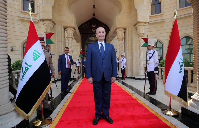 Newly elected Iraqi President Kurdish Barham Saleh greets the crowd during the handing over ceremony in Baghdad on October 3, 2018. Moderate Kurdish candidate Barham Saleh swept to the post of president of Iraq in a parliamentary vote pitting Kurdish heavyweights against each other for the first time following an ill-fated independence referendum. / AFP / SABAH ARAR