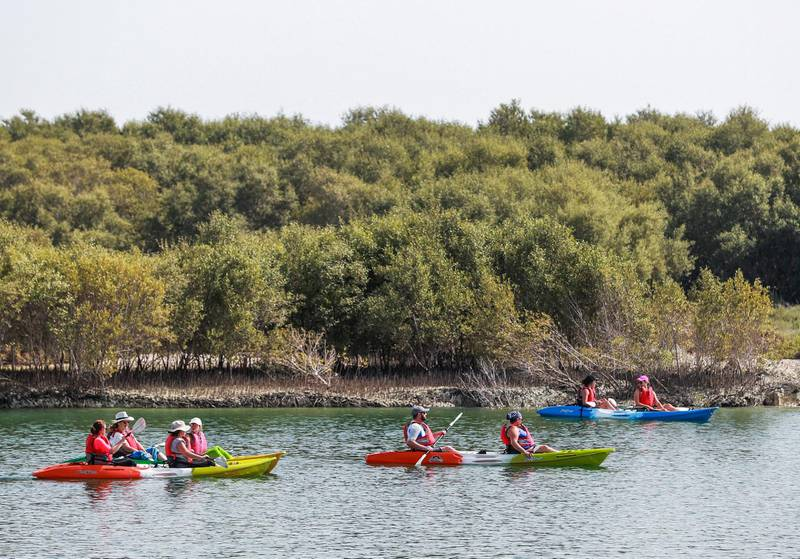 """Abu Dhabi, UAE,  April 15, 2018.  Stand alone images at the Eastern Mangroves Promenade.   """"Vive la France"""".   French tourists set off for a kayaking trip through the mangroves.Victor Besa / The NationalNationalFor:  Jake Badger"""