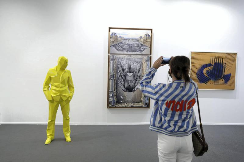 Dubai, United Arab Emirates - Reporter: Alexandra Chaves. Arts and Lifestyle. A visitor takes a picture in the Perrotin section. Art Dubai 2021 opens at the DIFC. Tuesday, March 30th, 2021. Dubai. Chris Whiteoak / The National