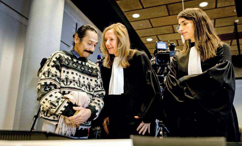 epa05764552 Chris Uktolseja (L), relative of a Groningen 1977 train hijacker, and lawyers Liesbeth Zegveld (C) and Brechtje Vossenberg (R) stand in the Court of The Hague, The Netherlands, 01 February 2017. The court ordered the probe into the deaths of the two hostage takers in the case of the train hijacking in 1977 as relatives of the Moluccans claim they were executed after a 19-days stand-off.  EPA/Remko de Waal *** Local Caption *** 53295773