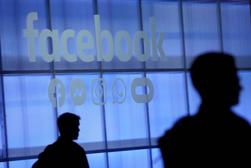 """(FILES) This file photo taken on April 30, 2019 shows the Facebook logo displayed during the F8 Facebook Developers conference in San Jose, California.  Facebook unveiled on June 18, 2019 its global crypto-currency """"Libra,"""" in a new initiative in payments for the world's biggest social network with the potential to bring crypto-money out of the shadows and into the mainstream.   / AFP / JUSTIN SULLIVAN"""
