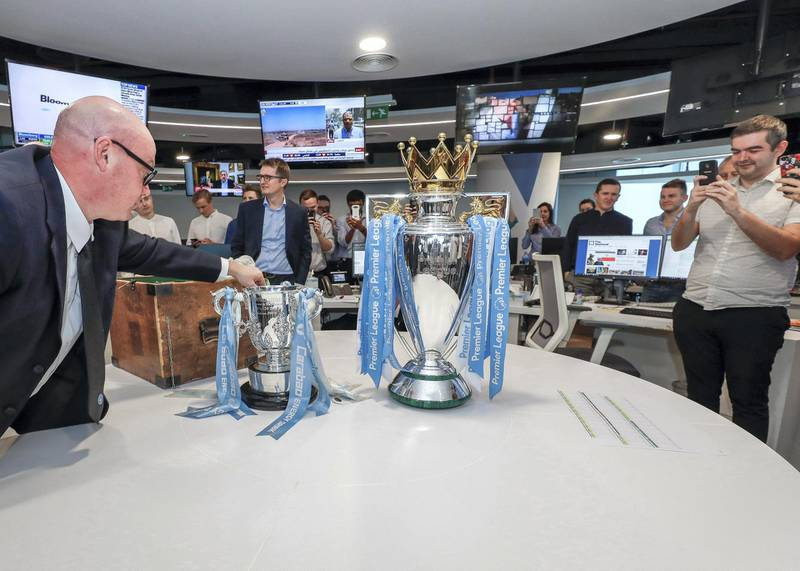 Abu Dhabi, U.A.E., July 3, 2018. The Premier League trophy visits the National offices by former Manchester City striker Paul Dickov.Victor Besa / The National