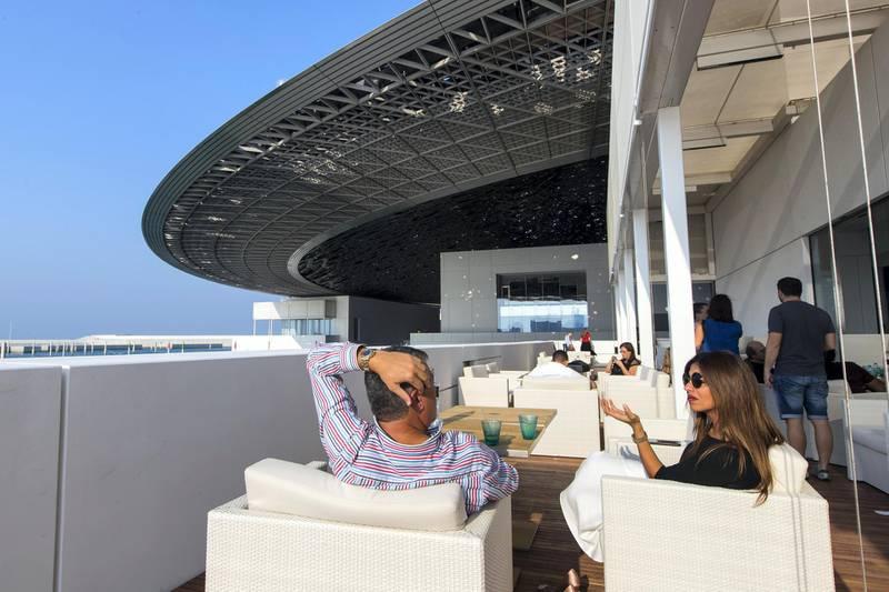 Abu Dhabi, United Arab Emirates, November 11, 2017:    Visitors sit at the restaurant on the opening day at the Louvre Abu Dhabi on Saadiyat Island in Abu Dhabi on November 11, 2017. Christopher Pike / The National  Reporter: James Langton, John Dennehy Section: News