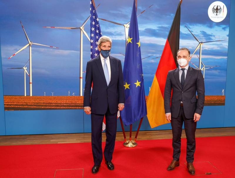 Germany's Foreign Minister Heiko Maas and U.S. Special Presidential Envoy for Climate John Kerry  pose for a photograph prior to a meeting at the Foreign Office in Berlin, Germany May 18, 2021. Odd Andersen/Pool via REUTERS
