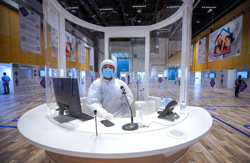 Abu Dhabi, United Arab Emirates, June 4, 2020.     An information officer at the center of the hall at the new Covid-19 Prime Assessment Center at ADNEC.Victor Besa  / The NationalSection:  NAReporter:  Shireena Al Nowais