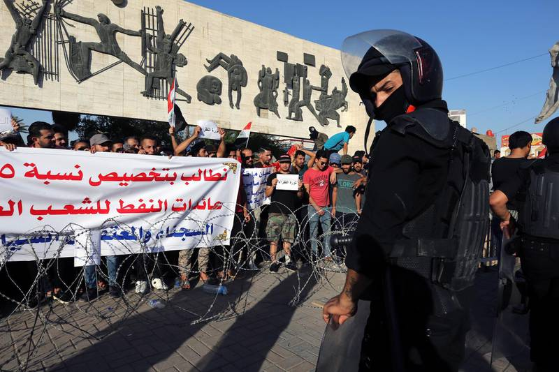 epaselect epa06901526 Iraqi riot forces stand guard ahead of Iraqi protesters during a demonstration  at al-Tahrir square, central Baghdad, Iraq, 20 July 2018. According to media reports dozens of protesters were injured in the clashes that followed the demonstration by thousands of Iraqis over unemployment, the rising cost of living and lack of services in Baghdad, as the Iraqi government had deployed a significant amount of military and police forces in various provinces in southern Iraq and areas in Baghdad.  EPA/AHMED JALIL