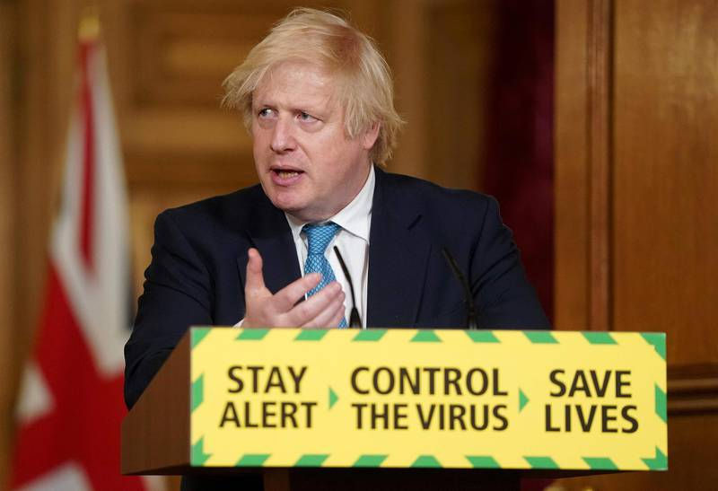 """A handout image released by 10 Downing Street, shows Britain's Prime Minister Boris Johnson attending a remote press conference to update the nation on the COVID-19 pandemic, inside 10 Downing Street in central London on June 16, 2020. Britain's government on Tuesday bowed to demands by Manchester United footballer Marcus Rashford to change its policy on free school meals for the poorest children, amid growing concerns about the impact of the coronavirus lockdown on low-income families. - RESTRICTED TO EDITORIAL USE - MANDATORY CREDIT """"AFP PHOTO / 10 DOWNING STREET  """" - NO MARKETING - NO ADVERTISING CAMPAIGNS - DISTRIBUTED AS A SERVICE TO CLIENTS  / AFP / 10 Downing Street / Pippa FOWLES / RESTRICTED TO EDITORIAL USE - MANDATORY CREDIT """"AFP PHOTO / 10 DOWNING STREET  """" - NO MARKETING - NO ADVERTISING CAMPAIGNS - DISTRIBUTED AS A SERVICE TO CLIENTS"""