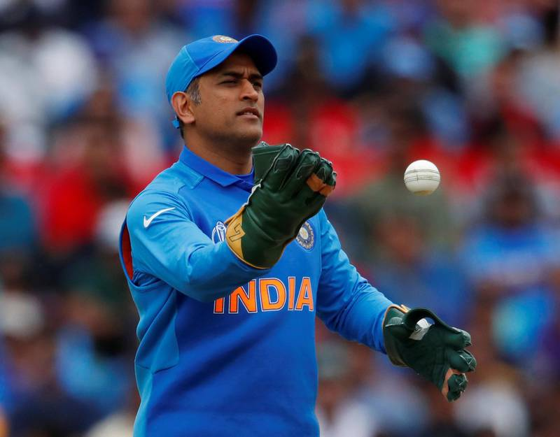 FILE PHOTO: Cricket - ICC Cricket World Cup - India v Australia - The Oval, London, Britain - June 9, 2019    India's MS Dhoni wearing his new gloves without an emblem on them    Action Images via Reuters/Andrew Boyers/File Photo