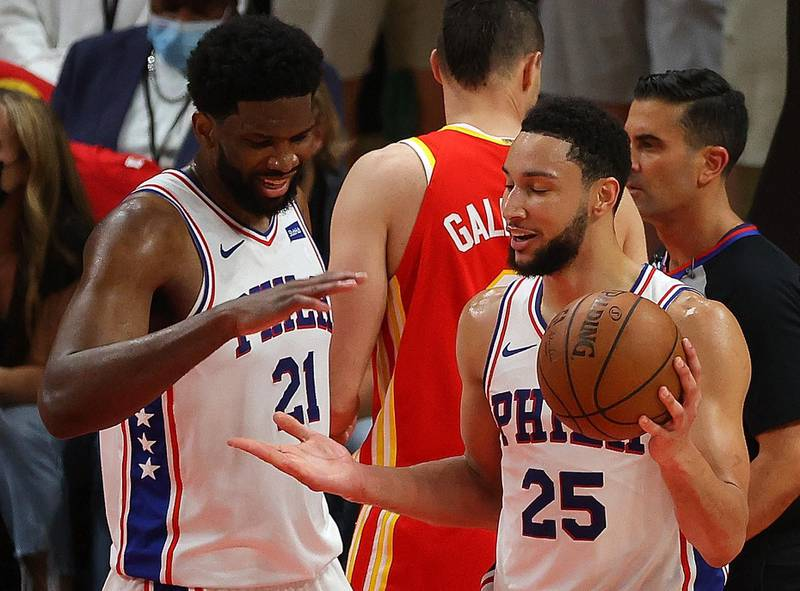 ATLANTA, GEORGIA - JUNE 11: Ben Simmons #25 and Joel Embiid #21 of the Philadelphia 76ers react during the second half of game 3 of the Eastern Conference Semifinals at State Farm Arena on June 11, 2021 in Atlanta, Georgia. NOTE TO USER: User expressly acknowledges and agrees that, by downloading and or using this photograph, User is consenting to the terms and conditions of the Getty Images License Agreement.   Kevin C. Cox/Getty Images/AFP == FOR NEWSPAPERS, INTERNET, TELCOS & TELEVISION USE ONLY ==