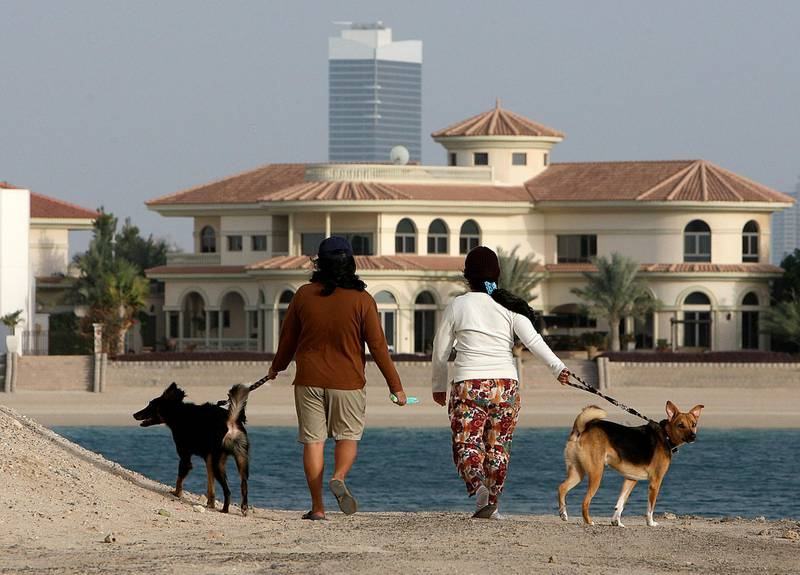 DUBAI, UNITED ARAB EMIRATES Ð Feb 7: Maids going for a walk with dogs in frond K at Palm Jumeirah in Dubai.  (Pawan Singh / The National) For House&Home. Story by Stella Rosato *** Local Caption ***  PS0702- PALM JUMEIRAH18.jpg