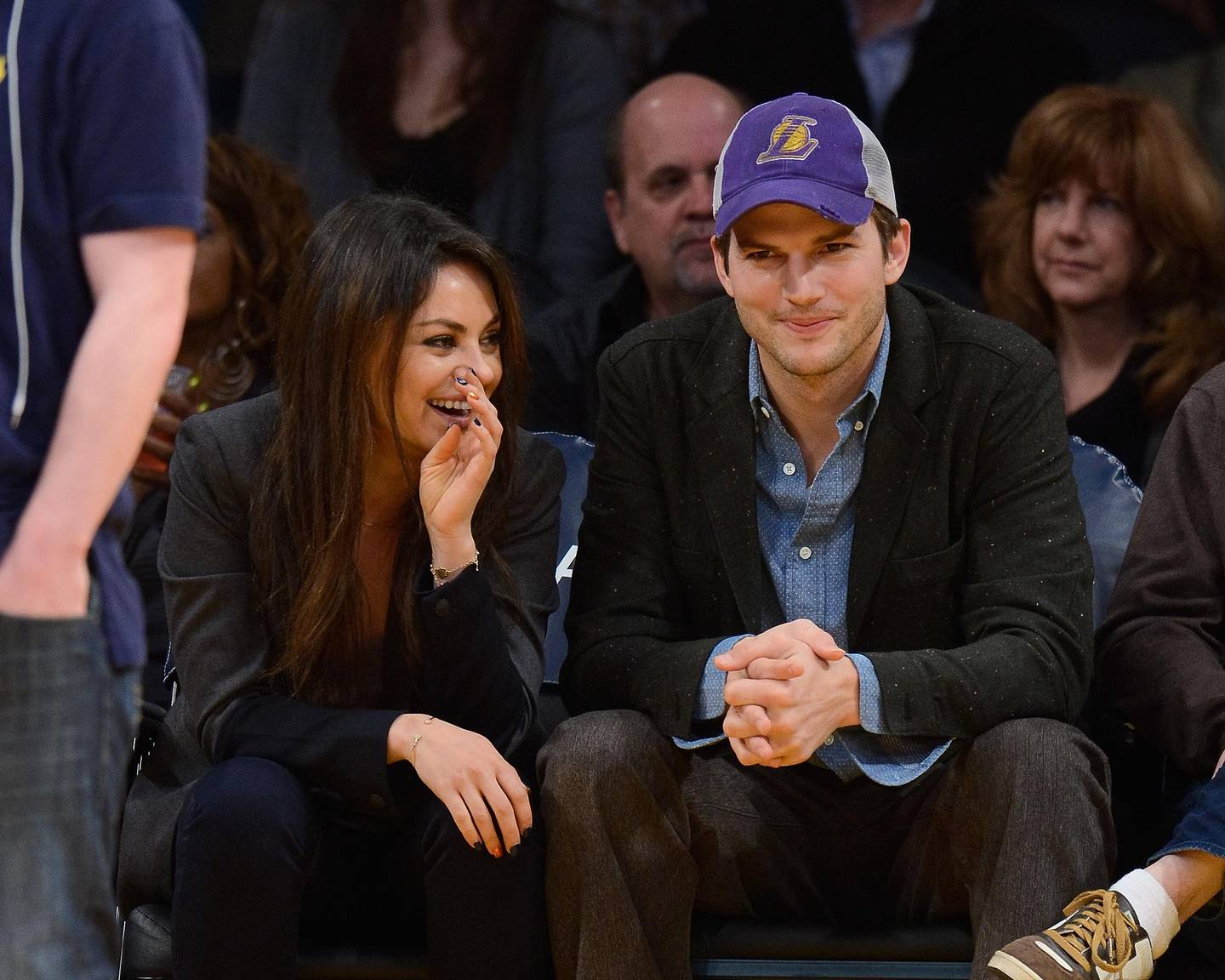 LOS ANGELES, CA - JANUARY 03:  Ashton Kutcher (R) and Mila Kunis attend a basketball game between the Utah Jazz and the Los Angeles Lakers at Staples Center on January 3, 2014 in Los Angeles, California.  (Photo by Noel Vasquez/Getty Images)