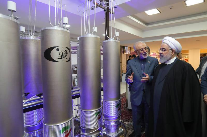 epa08105129 (FILE) - A handout photo made available by the presidential office shows Iranian President Hassan Rouhani (R) and the head of Iran nuclear technology organization Ali Akbar Salehi inspecting nuclear technology on the occasion of Iran National Nuclear Technology Day in Tehran, Iran, 09 April 2019 (reissued 05 January 2020). According to Iranian State TV reports, Iran will no longer keep any limits of 2015 nuclear deal. The decision comes after Iran's Quds Force leader Qasem Soleimani death on 03 January 2020 following a US airstrike at Baghdad's international airport.  EPA/IRANIAN PRESIDENCY OFFICE HANDOUT  HANDOUT EDITORIAL USE ONLY/NO SALES *** Local Caption *** 55326559
