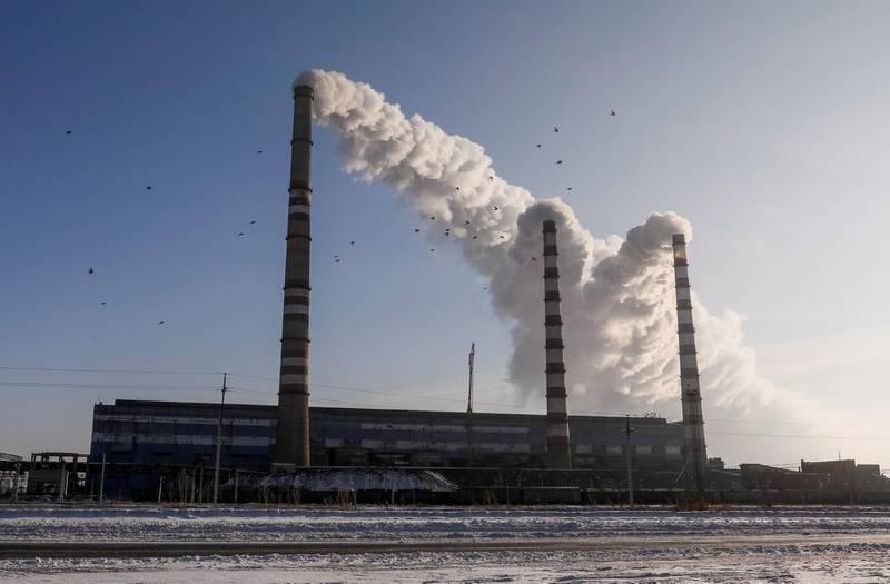 FILE PHOTO: Birds fly past Eurasian Resources Group's Aksu Power Plant on the outskirts of the town of Aksu, northeastern Kazakhstan, February 22, 2018.  REUTERS/Shamil Zhumatov/File Photo