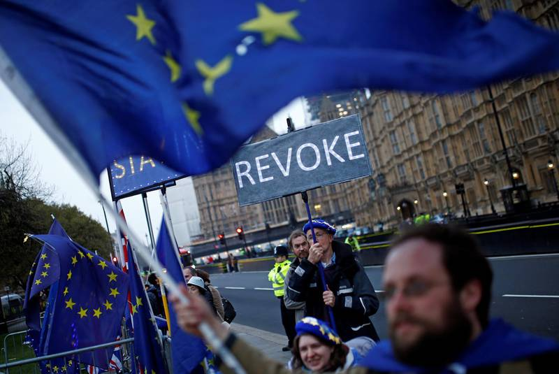 Anti-Brexit protesters are seen outside the Houses of Parliament, in London, Britain April 8, 2019. REUTERS/Henry Nicholls