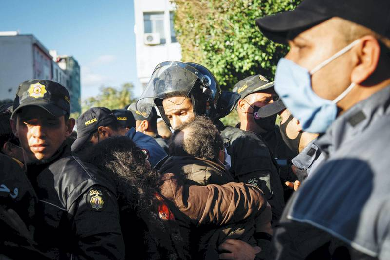 Police shoving protesters after deploying tear gas. Erin Clare Brown / The National